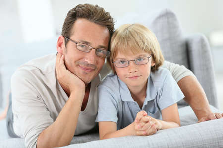 Portrait of daddy and son wearing eyeglasses photo