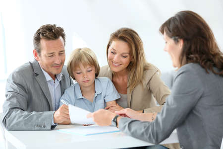 granting: Family meeting real-estate agent to buy new home