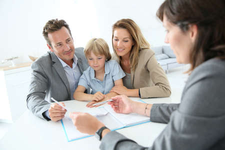 financial advice: Family meeting real-estate agent to buy new home
