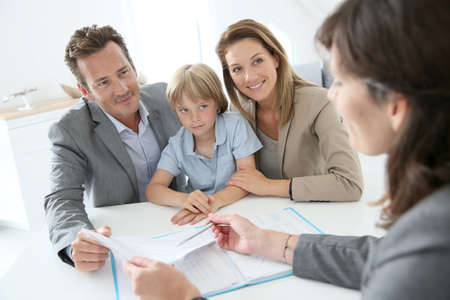 saleswomen: Family meeting real-estate agent to buy new home