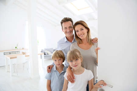 come home: Family welcoming people at entrance door Stock Photo