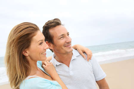 Happy 40-year-old couple enjoying day at the beach Stock Photo - 29378103