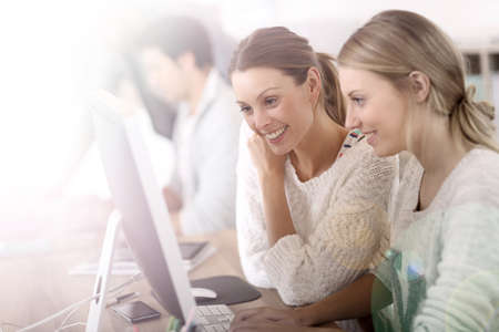 College girls working in front of desktop photo