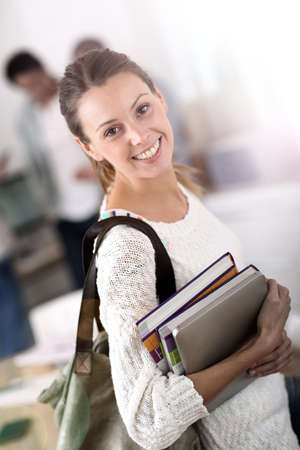 College girl holding books and going to class photo