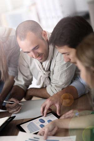 marketing plan: Business team working on marketing plan Stock Photo