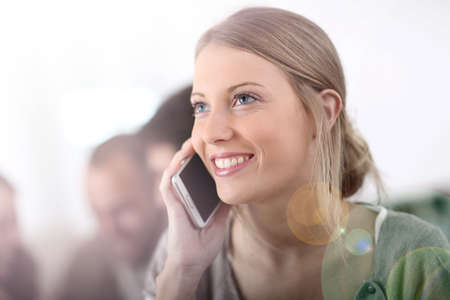 attractive young woman: Portrait of attractive young woman using cellphone