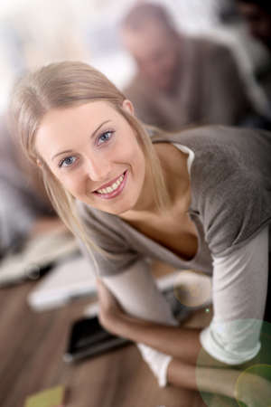 pretty young woman: Portrait of pretty young woman in office