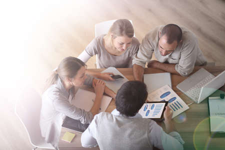 sales meeting: Upper view of business people around table Stock Photo