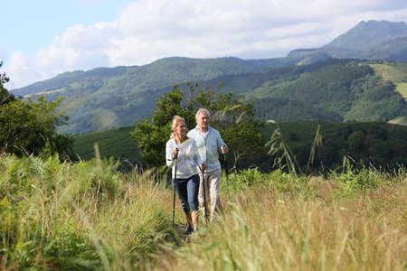 rambling: Senior people hiking in beautiful natural landscape