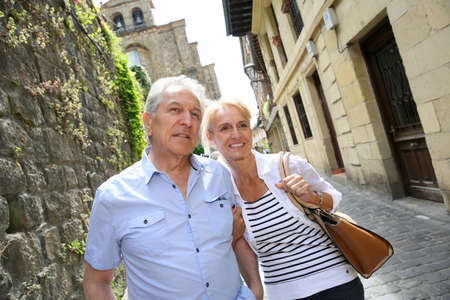 retired couple: Senior couple visiting northern spanish town Stock Photo