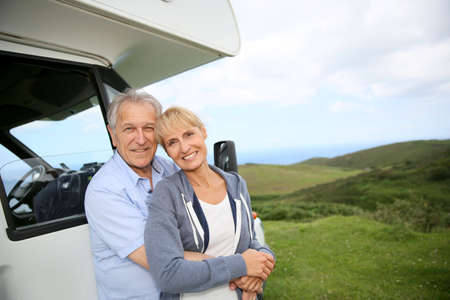 motorhome: Senior couple standing by motorhome in countryside