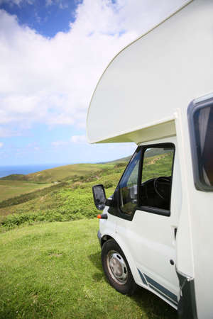 motorhome: View of camper parked on hill by the sea