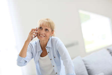 phonecall: Senior woman talking on mobile phone