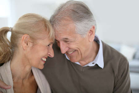 Cheerful senior couple looking at each others eyes