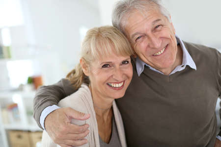 elderly couple: Cheerful senior couple embracing each other