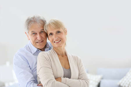 Cheerful senior couple embracing each other photo