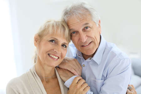 Portrait of senior and happy senior couple photo