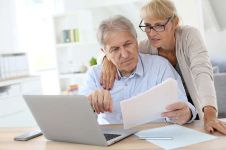 Senior couple doing the income tax declaration online Фото со стока - 30222425