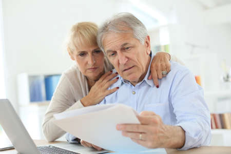 inquiring: Senior couple doing the income tax declaration online