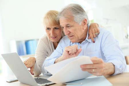 declaration: Senior couple doing the income tax declaration online