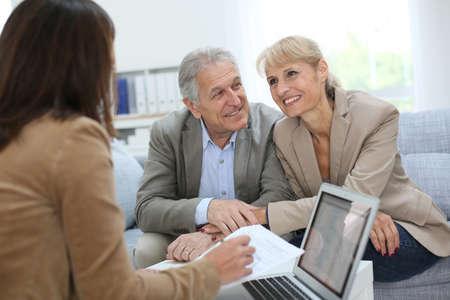Senior couple meeting real estate agent