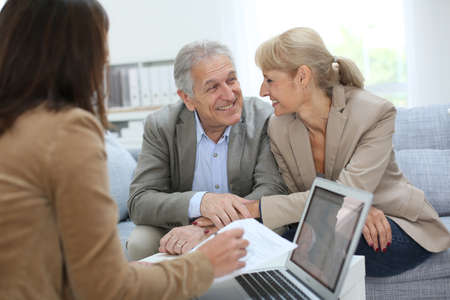 financial adviser: Senior couple meeting real estate agent