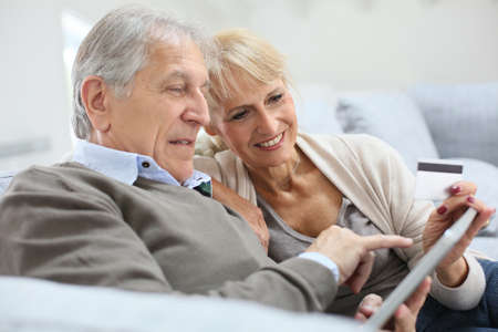 secured payment: Senior couple e-shopping with digital tablet