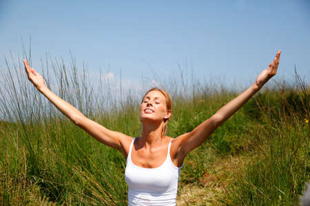 Woman in countryside doing yoga exercices photo