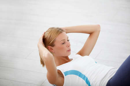crunches: Woman doing crunches in gym Stock Photo