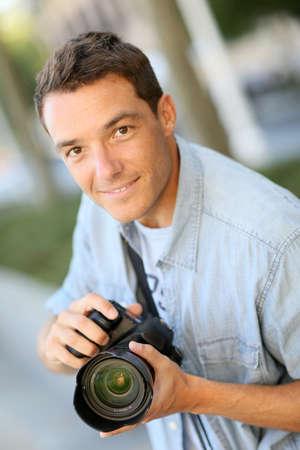 reflex: Photographer using reflex camera outside