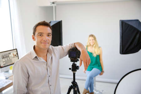 Fashion photographer at work in studio photo