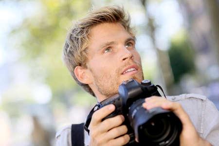 outside shooting: Photographer shooting outside with digital camera