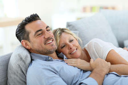 couple on couch: Mature couple relaxing in sofa at home