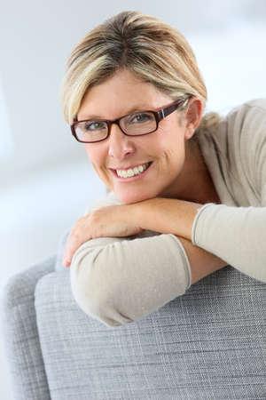 Portrait of mature woman wearing eyeglasses Stock Photo