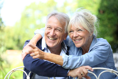 couple home: Senior couple enjoying day outside Stock Photo