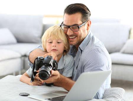 reflex: Man with little boy playing with reflex camera