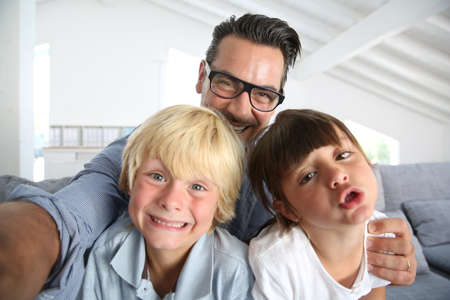 selfy: Dad with kids taking picture of themselves Stock Photo