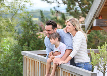 Family enjoying vacation in log cabin Stock Photo
