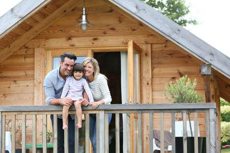 Family enjoying vacation in log cabin Foto de archivo