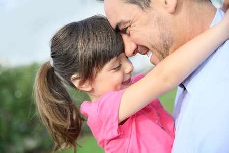 kids hugging: Portrait of little girl hugging her daddy