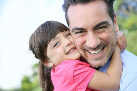 father daughter: Portrait of little girl hugging her daddy
