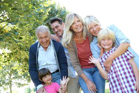 family photo: Happy 3 generation family in grandparents backyard Stock Photo