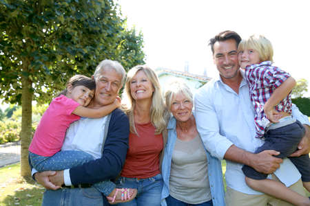 Happy 3 generation family in grandparents backyard photo