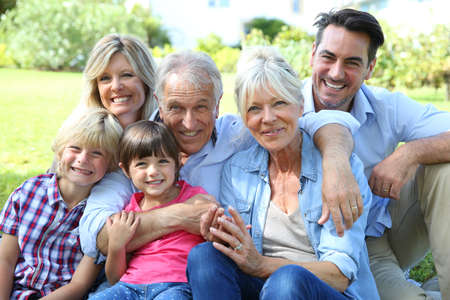family picture: Happy 3 generation family in grandparents backyard Stock Photo