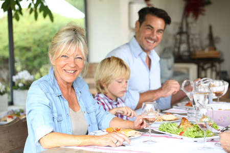 Family having summmer lunch in country house Stock Photo