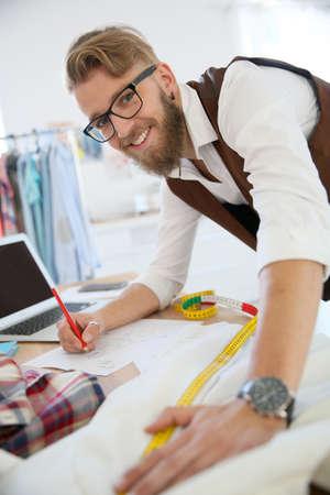 Fashion designer in workshop Stock Photo