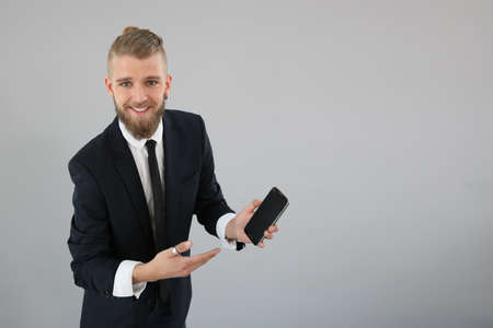 Young businessman using smartphone, isolated photo