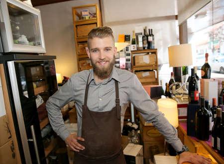 Man working in wine shop photo