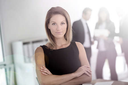 Portrait of attractive businesswoman, people in background photo
