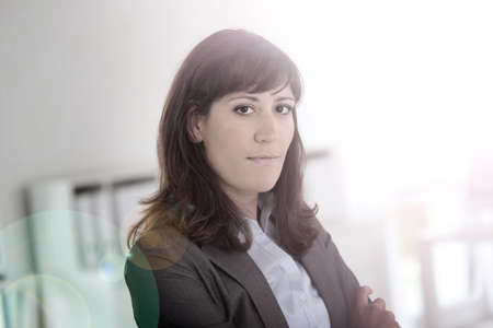 30 years old woman: Smiling young businesswoman looking at camera